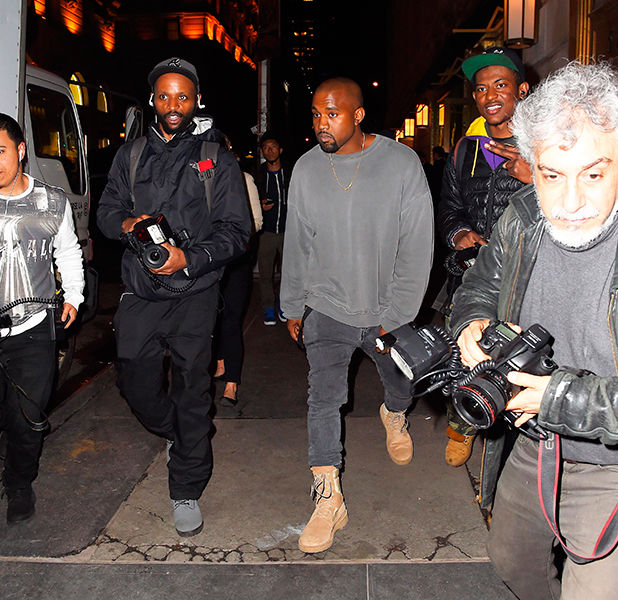 Kanye West gets a paparazzi escort to his Car because he couldnt' find it, after dinner with Kim Kardashian at 'The Polo Bar' 22 Apr 2015