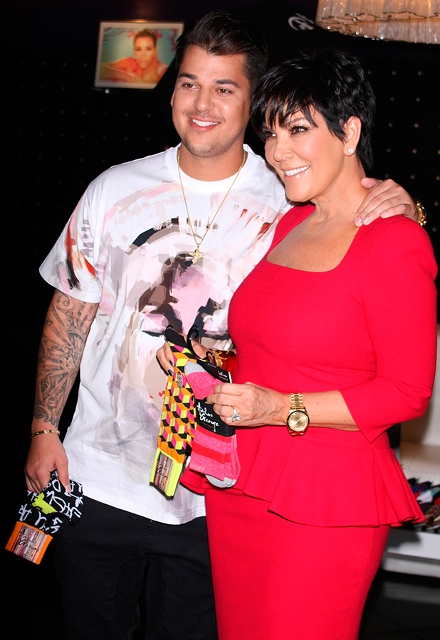 Rob Kardashian and his mother promote 'Arthur George by Robert Kardashian' socks at Kardashian Khaos inside The Mirage Resort and Casino, 2013