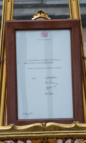 The birth of the Duke and Duchess of Cambridge's new daughter is confirmed on an easel outside Buckingham Palace - 2 May.