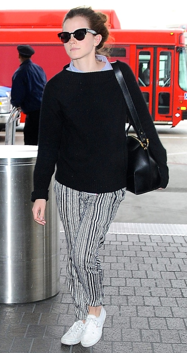 Emma Watson in striped trousers and black jumper at LA Airport 25 april