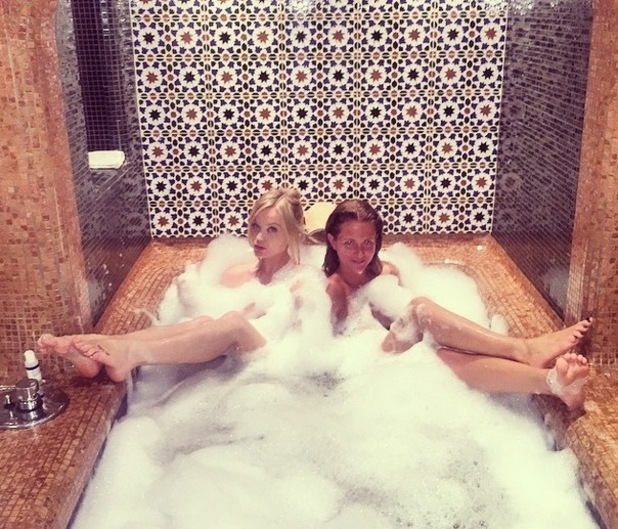 Laura Whitmore and Millie Mackintosh in the bath, Ibiza 27 April