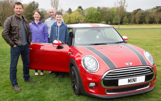 George Baldwin and his family with his new Mini Cooper