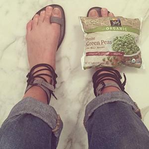 Karlie Kloss ices her swollen foot after the Met Ball