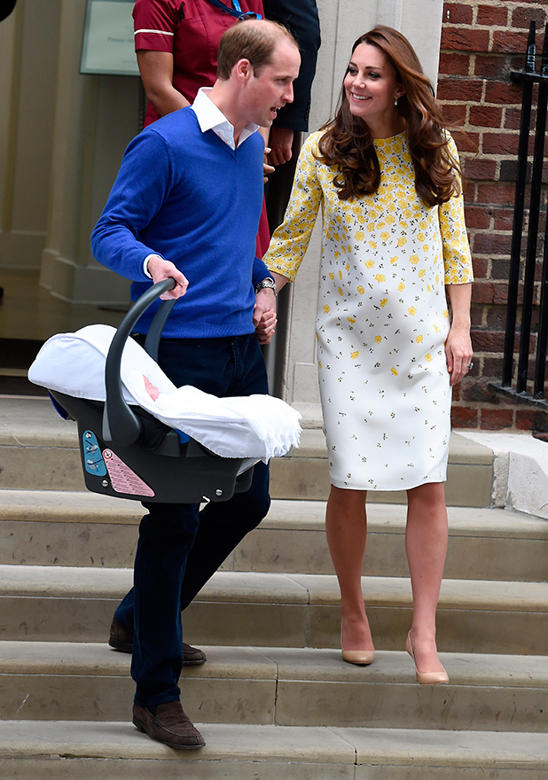 Catherine Duchess of Cambridge, wearing a Jenny Packham dress, and Prince William, Duke of Cambridge leave the Lindo Wing at St. Mary's Hospital with their new born baby daughter on May 02, 2015 in London, England.