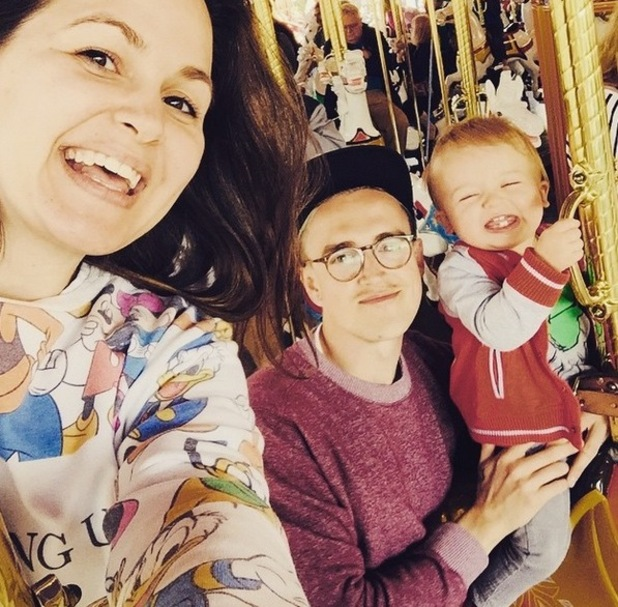 Giovanna Fletcher, Tom Fletcher and Buzz enjoy a carousel ride in Disney World, May 2015
