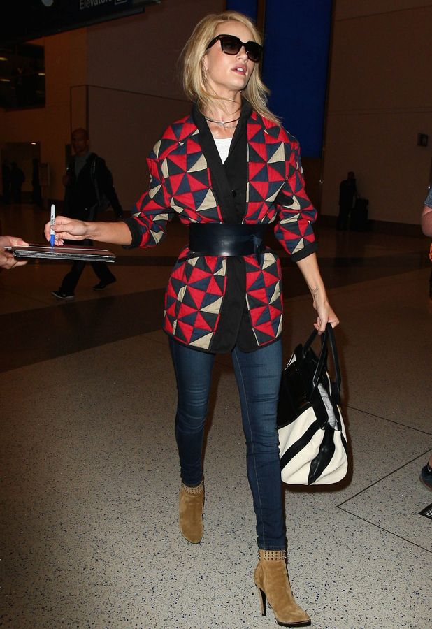 Rosie Huntington-Whiteley signs autographs at LAX airport 14th May 2015