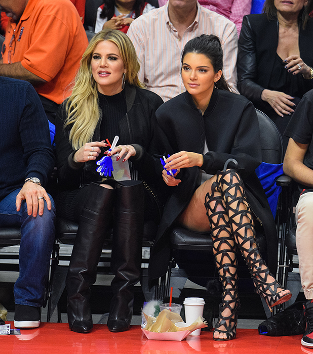 Khloe Kardashian (L) and Kendall Jenner attend a basketball game between the Houston Rockets and The Los Angeles Clippers at Staples Center on May 8, 2015 in Los Angeles, California.