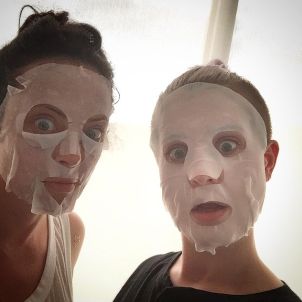 Kelly Osbourne poses with Jennifer Holliday, wearing scary facial cloth masks, 24 May 2015