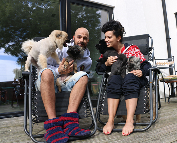 Abz, Vicky (L-R) at home with their dogs in Barry, Wales.