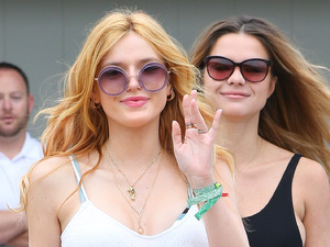 Bella Thorne wows in white maxi dress & bikini at star studded party!