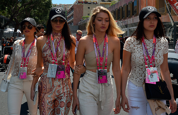 Kendall Jenner (2ndL), Gigi Hadid (2ndR) and Bella Hadid (R) attend the Monaco Formula One Grand Prix at the Monaco street circuit in Monte-Carlo on May 24, 2015. AFP PHOTO / BORIS HORVAT