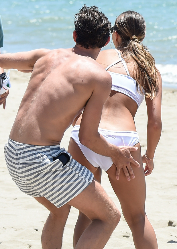 Jake Hall touches Chloe Lewis' bottom while playing volleyball in Marbella - 3 June 2015.
