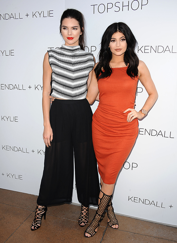 Kendall Jenner and Kylie Jenner attend the Kendall + Kylie fashion line launch party at TopShop on June 3, 2015 in Los Angeles, California. (Photo by Jason LaVeris/FilmMagic)