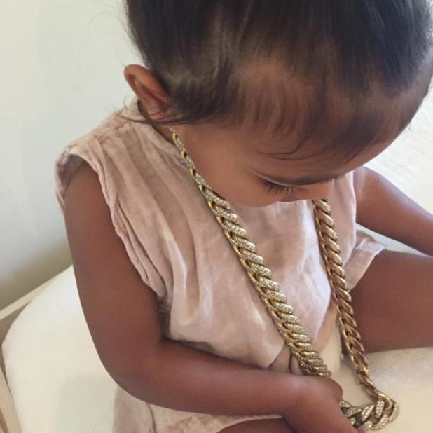 Kim Kardashian shares cute snap of daughter North wearing daddy Kanye West's chunky chain, 12 June 2015