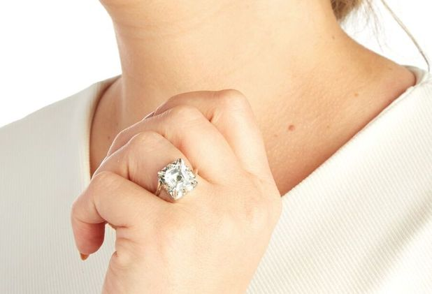 GPS engagement ring with tracking device by Gemporia as worn by model