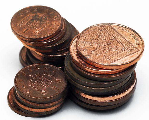 1p and 2p coins in a pile - A bus driver called police after Laura Pulley tried to pay her fare in coppers