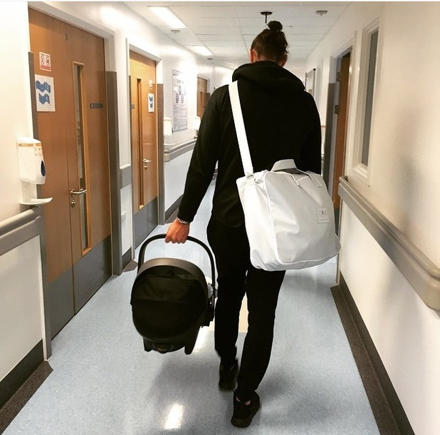 Billi Mucklow shares snap of Andy Carroll leaving hospital with their newborn baby boy, 16th June 2015