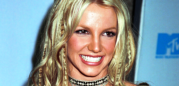 Britney Spears poses for photographers at the 2000 MTV Video Music Awards September 7, 2000 at Radio City Music Hall in New York City. (Photo by George DeSota/Liaison)