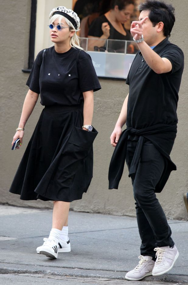Rita Ora in New York with pal, black skirt and trainers 22nd June 2015