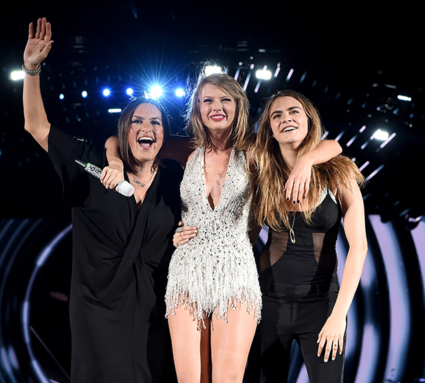 Mariska Hargitay, Taylor Swift, and Cara Delevingne pose onstage during The 1989 World Tour on June 12, 2015 at Lincoln Financial Field in Philadelphia, Pennsylvania. (Photo by Dimitrios Kambouris/LP5/Getty Images for TAS)