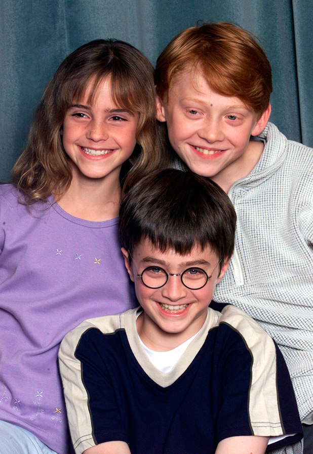 Actors Emma Watson (L), Daniel Radcliffe (C) and Rupert Grint (R) attend a press conference for the movie 'Harry Potter and The Philosopher's Stone' in London on August 23, 2000. They are to play the main characters of Hermione Granger, Harry Potter and Ron Weasley in the film of the popular book by JK Rowling. (Photo by Dave Hogan/Getty Images)
