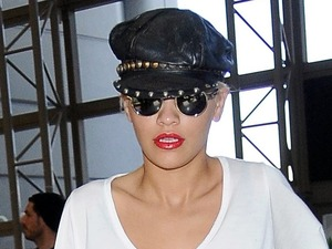 Rita Ora finally covers up her assets in oversized tee and jeans!
