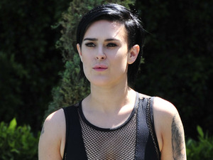 Rumer Willis flaunts her enviably trim figure in mesh bikini!