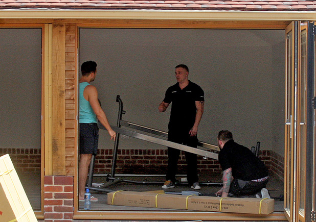 Mark Wright helps with the installation of his new state-of-the-art home gymnasium - Abridge, Essex. 1 July 2015.