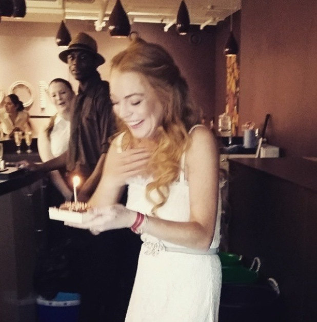 Lindsay Lohan blowing out birthday candle at Magnum Pleasure store launch 01/07/15