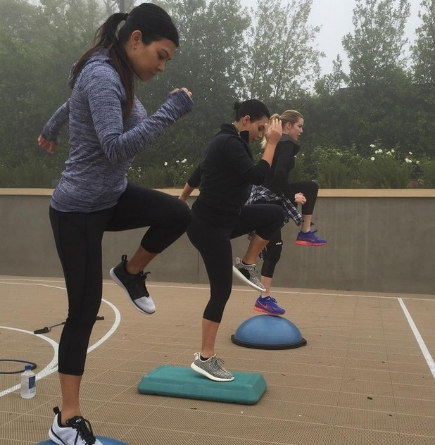 Kourtney Kardashian works out with her sisters Kim and Khloe, 7th July 2015