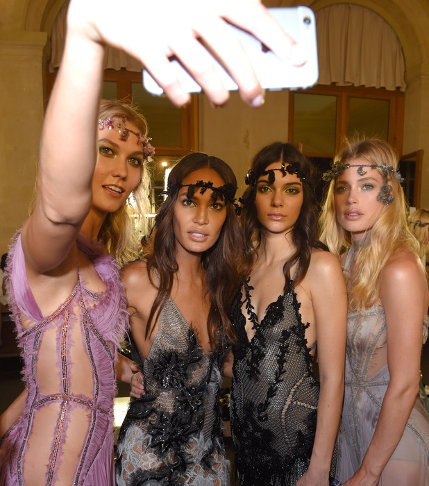 Kendall Jenner, Karlie Kloss, Joan Smalls and Doutzen Kroes take selfie at the Paris Fashion Week Atelier Versace Show 6th July 2015