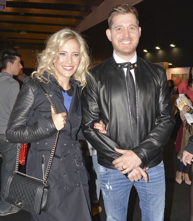 Michael Buble and wife Luisana Lopilato at the Mercedes-Benz Madrid Fashion Week Fall/Winter 2015 - 8 February 2015.