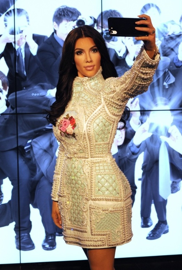 Madame Tussauds unveil a new wax figure of Kim Kardashian which takes selfies against changing location backdrops at Madame Tussauds on July 9, 2015 in London, England.