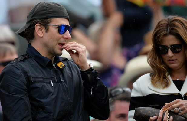 Bradley Cooper and Mirka Federer during day nine of the Wimbledon Lawn Tennis Championships at the All England Lawn Tennis and Croquet Club on July 8, 2015 in London, England.