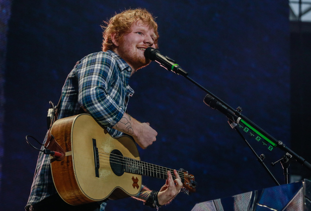 Ed Sheeran performs on stage at Wembley Stadium on July 10, 2015 in London, England.