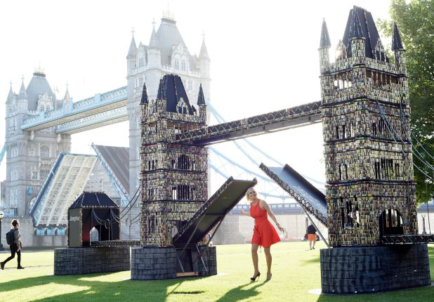 Giant working Tower Bridge model made from 83,000 old batteries, London, Britain - 21 Jul 2015 Pollyanna Woodward with the giant Tower Bridge model made out of batteries