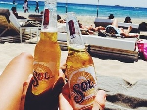Proudlock and Emma Connolly drinking Sol beer in Ibiza June 2015