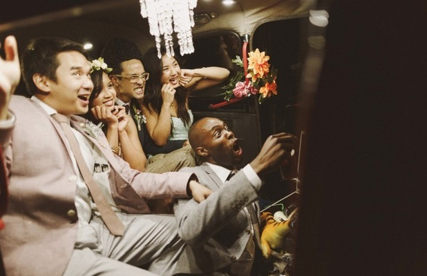 WEDDING GUESTS IN A PHOTOBOOTH TAXI