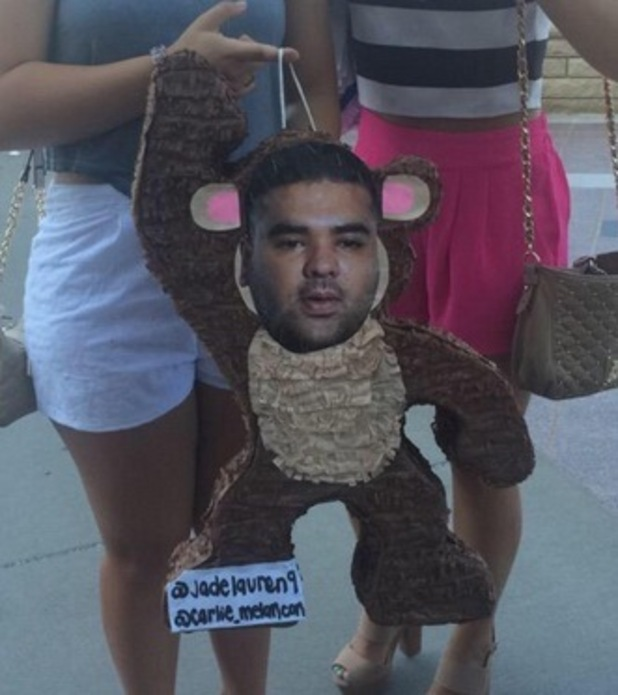 A pinata with Naughty Boy's face on made by fans is brought to a 1D show in Kansas, 29th July 2015