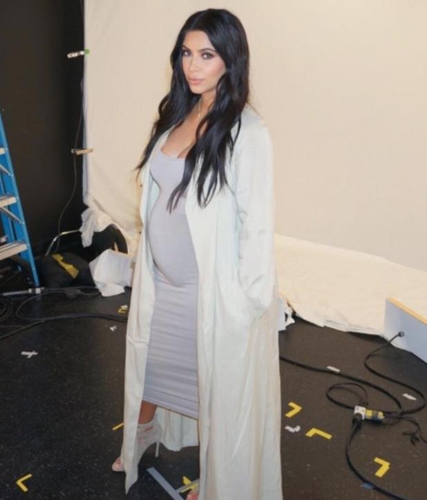 Kim Kardashian takes selfie of her growing baby bump, July 2015