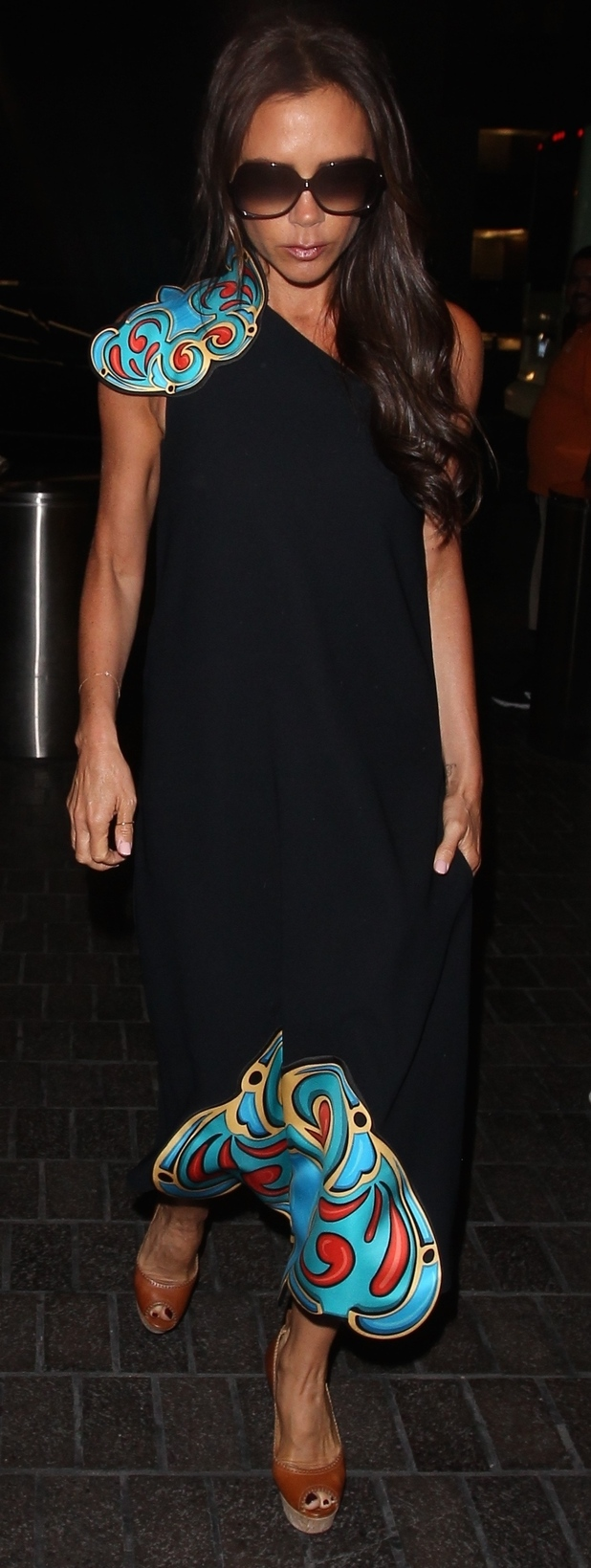 Victoria Beckham wears dress from her own collection at L.A.X Airport, 3rd August 2015