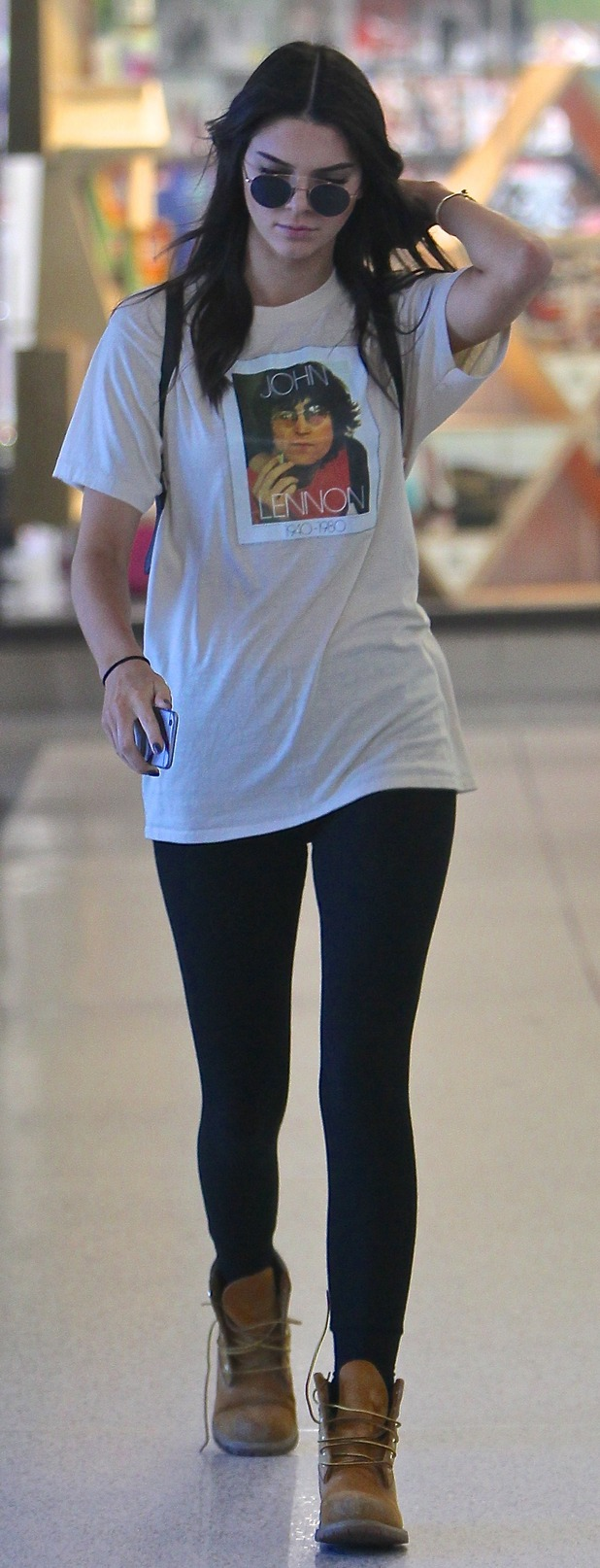 Kendall Jenner at L.A.X Airport in loose fitting band tee, 12th August 2015