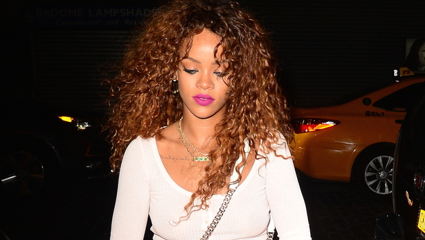 Rihanna out and about in New York wearing cut-out trousers 13th August 2015