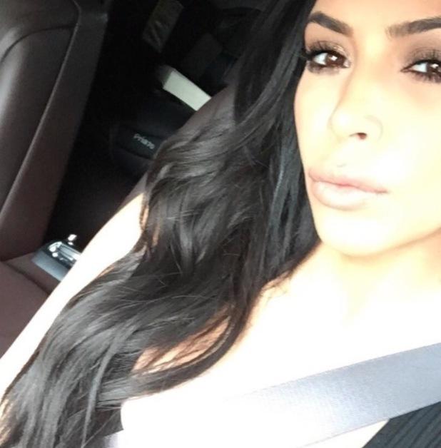 Kim Kardashian posts hair selfie to Instagram, down 'do 13th August 2015