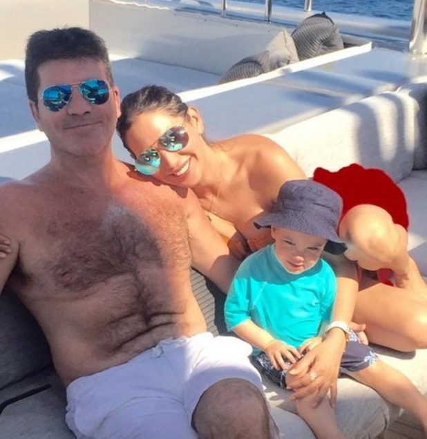 Simon Cowell, Lauren Silverman and son Eric on holiday in Ibiza, 11th August 2015