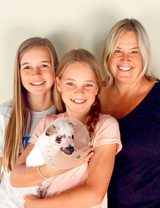 Christine Doblar and daughters have now adopted Lisa the puppy with facial chemical burns Aug 2015