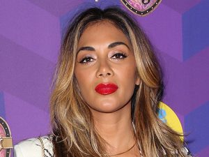 Nicole Scherzinger puts on an incredibly busty display at celeb bash!