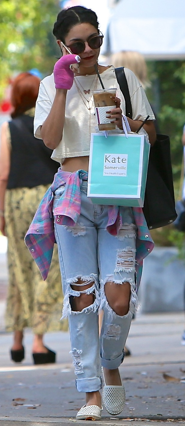 Vanessa Hudgens out and about in Los Angeles wearing distressed jeans and a cropped t-shirt 27th August 2015