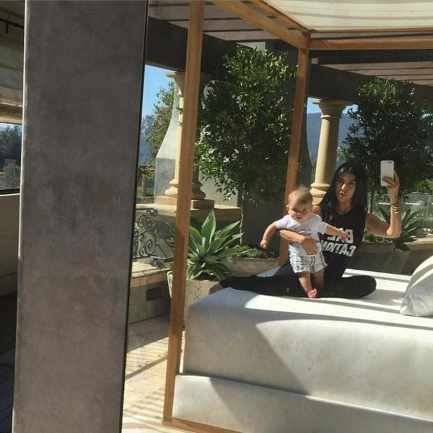 Kourtney Kardashian and son Reign, 28 August 2015.
