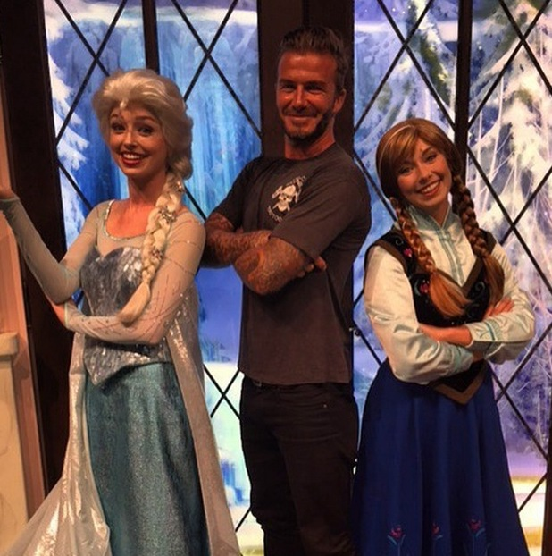 David Beckham poses with Frozen Queen Elsa and Princess Anna, 25th August 2015